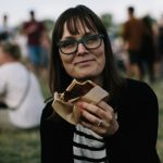 """We caught Lea Sarfelt of Roskilde enjoying some toast from Hjaltes. """"Really good! Especially when you have a hangover,"""" she said. Photo: Bobby Anwar"""