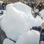 """Olafur Eliasson installed 12 huge blocks of Greenland ice at Copenhagen's City Hall Square in collaboration with geologist Mias a 'wake-up call' ahead of the IPCC meeting in Copenhagen. """"We, the world, must and can act now. Let's transform climate knowledge into climate action,"""" the pair said. Photo: Søren Bidstrup/Scanpix"""