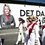 A parade marking 100 years of a woman's right to vote passes an election campaign for Denmark's first female prime minister. Photo: Mathias Løvgreen Bojesen/Scanpix