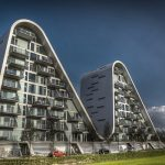 """<b>Vejle</b><br> A large town on the eastern shore of Jutland, Vejle is most known for its forested hills, fjord, harbor, and iconic windmill. The fjord is also the site of the stunning apartment complex called Bølgen (""""The Wave"""").Photo: <a href=""""https://www.flickr.com/photos/60069099@N03/"""">Mikkel Rask/Flickr</a>"""