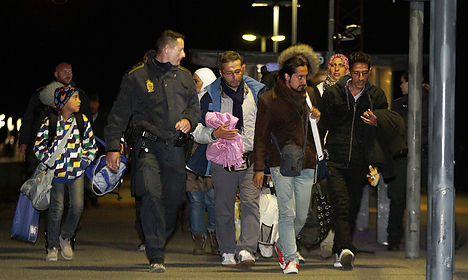 Refugees flee from police in Danish port town