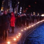 A chain of 1,800 candles lit on a 3.6 kilometre (2.2 mile) route between the two locations attacked. Photo: Claus Bech/Scanpix