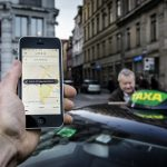 Uber halts services in Denmark after new taxi law