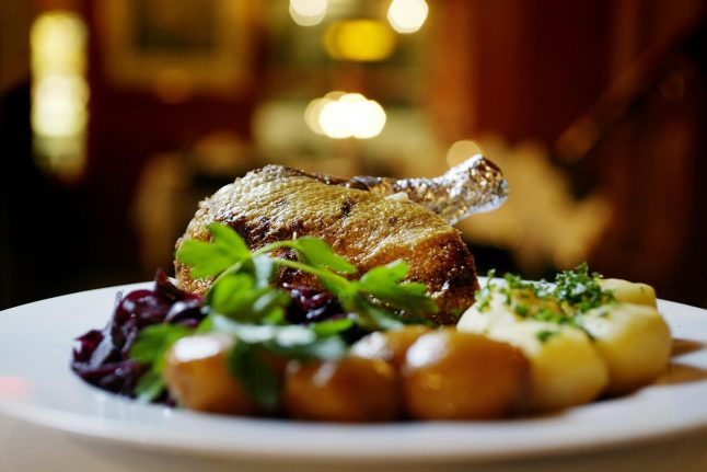 Why do Danes eat duck and pork at Christmas?