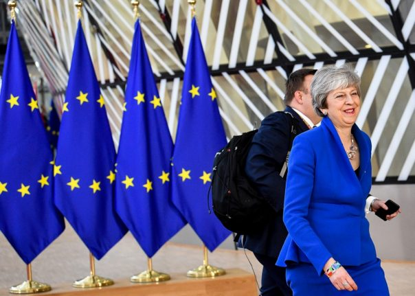 EU agrees to delay Brexit until end of October after tense summit