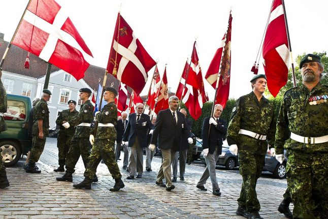 Why are flags flying in Denmark today?