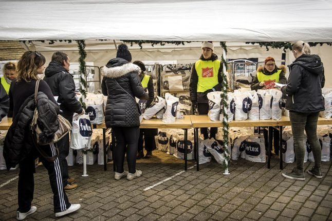 Why are record numbers in Denmark asking for charity help this Christmas?