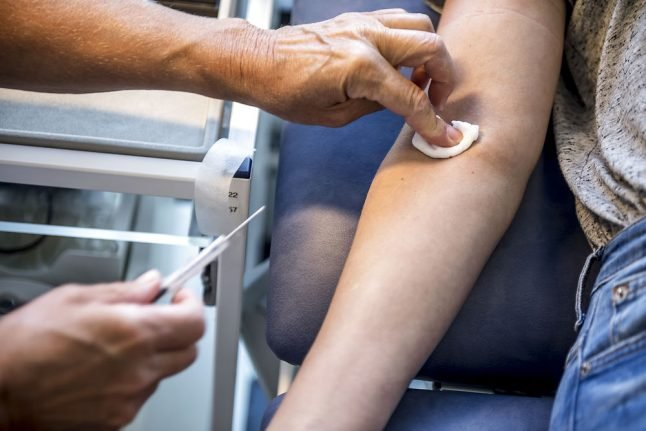 What are Denmark's rules for giving blood?