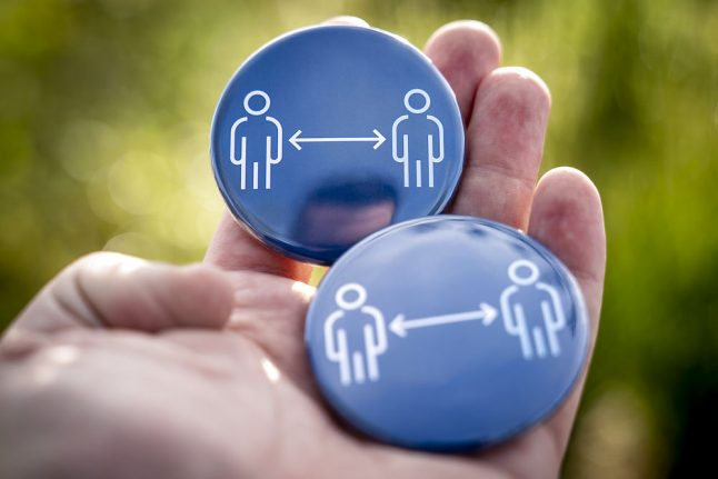 Why people in Denmark are wearing 'social distance badges'