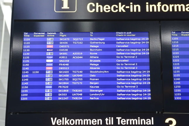 Departures information at Copenhagen Airport. Denmark is to ease and simplify its Covid-19 travel restrictions by the end of October..