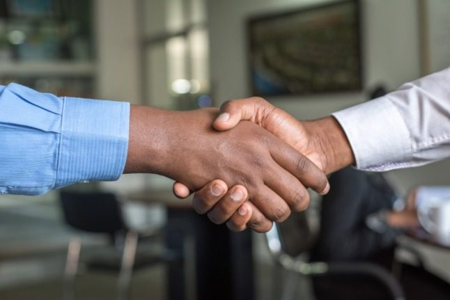 A job interview handshake. New Danish rules could prevent employers from asking the age of potential new staff.